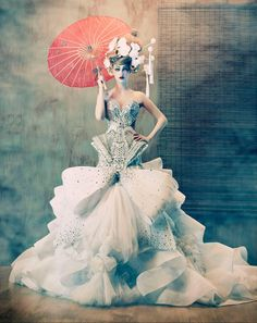 Simply gorgeous couture. Looks like a high fashion couture wedding gown splashed with some East Asian accents.
