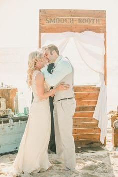 A smooch booth on the beach is such a cute ceremony backdrop for this stunning destination wedding.
