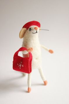 This needle felted mouse is a real mouse - lady! She wears red hat and red winter-style bag. Isnt she sweet? Miniature cute holiday figurine is a great home decor for Christmas time and nice gift idea for friends or family members on Christmas. It is nice collectable woolen animal and great present for everyone who admires handmade Eco-friendly creations. Mouse has a cute and sweet face, it has a wired skeleton inside and you can move its legs and tail. Mouse figurine is about 10cm (4…
