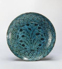 Name: Dish Place of creation: Iran Date: 17th - first third of 18th century Material: faience Technique: painted in black under transparent turquoise glaze Dimension: diam. 32 cm