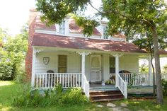 """This historic c. 1715 cottage sits on 1/2 acre creek-front lot. Documented history and lots of potential. Beautiful lot and has views of the Sound. Sold """"As Is"""" needs work on house and needs new dock."""