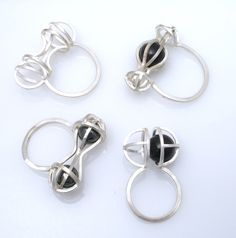 Kinetic rings, sterling silver, hematite, glass; by Gina Pankowski