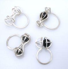 Kinetic rings, sterling silver, hematite, glass; by Gina Pankowski
