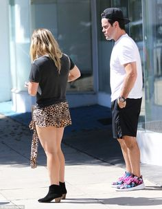 Eye-catching: Hilary donned a leopard print skirt and Mike sported vibrant tropical sunset...