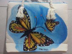 Bolsa de manta con mariposa amarilla.