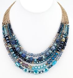 """Multiple strands of faceted glass beads on shiny gold chains creating a beautiful blue statement necklace. 18"""" long glass/shiny gold metal made in China Necklac"""
