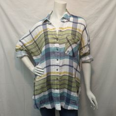 Plaid button front tunic top. -100% Cotton -Imported Item is pictured with jeans that can be found by clicking here.