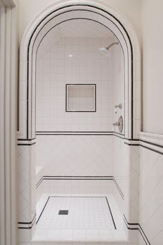 12 Ideas For Designing An Art Deco Bathroom Discover stylish art deco bathroom design ideas. Art Deco influenced the black and white design. White Tile Shower, White Bathroom, Modern Bathroom, Master Bathroom, Bathroom Mirrors, Glass Bathroom, Accent Tile Bathroom, Small Tile Shower, 1930s Bathroom