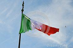 The Italian flag waving in the sky