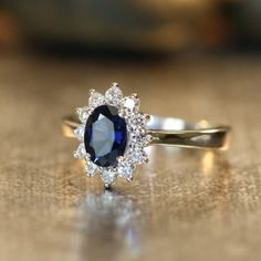 Halo Diamond and Natural Blue Sapphire Ring 18k by LaMoreDesign, $1,385.00