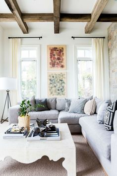 Wood and white, along with grey couch and simple elements is in perfect harmony