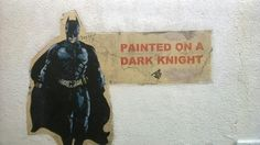Batman street art painted on a dark knight.