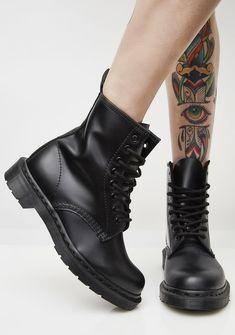 Dr. Martens Black 1460 Mono Boots got ya totally blacked out. These combat boots have thikk treaded soles, a pull tab on the back, and lace-up front closures.