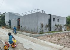 Concrete house by South Korean studio AND features glazed incisions