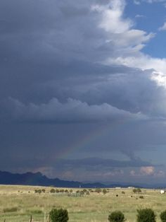 rainbow in the storm clouds Southern Arizona summer storm rolling through.  Beautiful!