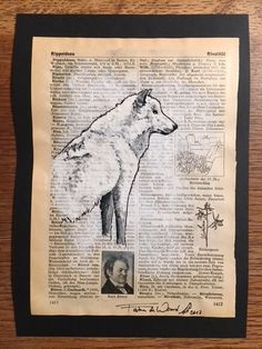 Wolf 8 - this arctic wolf is painted on an old lexicon-page =)