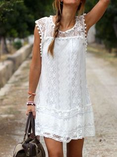 Front view of model in white lace shift dress