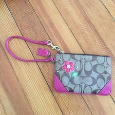 Coach Wristlet Girly and flirty. Little pull in leaf of design (shown). Pink and brown. Perfect pink interior. Gold hook is slightly tarnished. Price reflects the imperfections. Coach Bags Clutches & Wristlets