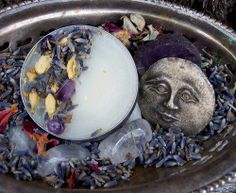 perfect as a small altar; silver bowl or tray, herbs (lavender) and flower petals, crystals, sun/moon image, candle