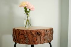Tree decor is everywhere these days — from branch chandeliers and coat hooks to log pedestals and candle holders. When Jennifer and I saw these log side tables in Domino ma