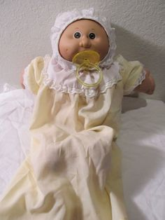 """The next year or so, Santa brought a Cabbage Patch Kid """"Preemie,"""" complete with pacifier.  She always smelled like baby powder.  Mom sewed an entire bassinette and layette set for her, too.  By the way, what a horrible concept for a kids' toy: a  premature (and therefore smaller) baby!"""