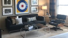 This studio apartment offers a model in convenient city living: utilities are included with rent & the express bus to downtown Chicago stops right outside the building's entrance. This studio is also clearly dedicate to its 1960s Mod decor, with artwork that evokes the youth movement of the '60s and the classic furniture, including the Eames Chair, that roots the place in a mid-century modern theme. | Domu Chicago Apartments