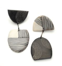 Tribal Earrings by Kathleen Dustin. Lightweight and easy to wear, these earrings have intricately hand-applied details. They are made of colored polymer with a sterling post and dangle ever so slightly. These asymmetrical earrings are predominantly black & white.