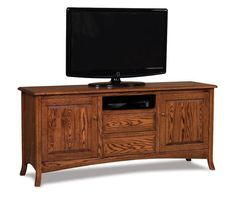 Amish Carlisle TV Stand with Two Doors and Two Drawers Amish Carlisle TV Stand with Two Doors and Two Drawers. Shown here in rich oak wood with nutmeg stain. Solid wood storage that creates a centerpiece in your living room. #DutchCrafters