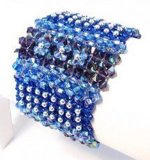 This woven bead cuff bracelet will add a burst of blue to your look. With its royal blue tones and sparkling crystals, the Cobalt Blue Elegance Bracelet has a very regal air about it. You'll command attention with this intricate cuff.