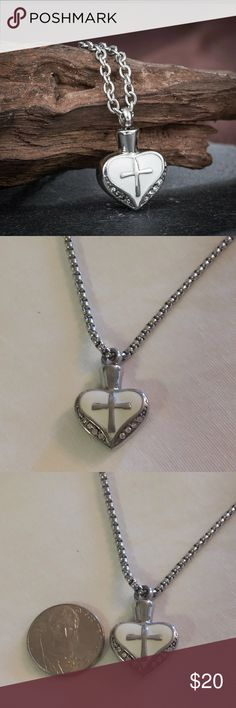 """Heart w/ cross cremation urn necklace Heart w/ cross cremation urn necklace. 316L stainless steel. Rhinestones  on each side.  Can be a man or a woman's necklace. 18"""" chain with 2"""" extender.  Heart pendant is .75"""" long. Jewelry Necklaces"""