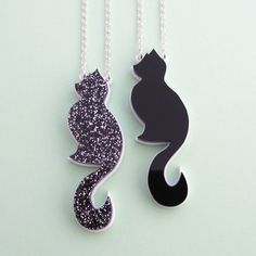 This cute cat necklace comes in plain black or black and silver glitter acrylic on a white acrylic background. Perfect for cat people everywhere!Pendant is approximately cm tall and cm wide. Silver plated chain is approx. Crazy Cat Lady, Crazy Cats, Fairy Cakes, Glitter Acrylics, Cat Necklace, Cat Lover Gifts, Cat Lovers, Cat Crafts, Plain Black