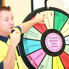 """""""Spin that wheel!"""" could be heard yelled throughout the crowded room while students cheered on their fellow peers. Quinton, NJ students spun a PBS ticket wheel with prizes listed including a special lunch that gives kids an opportunity to be waited on by a school staff member. Buy this Prize Wheel at http://PrizeWheel.com/products/floor-prize-wheels/floor-table-black-clicker-prize-wheel-12-slot/."""