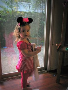 and there is my Minnie Mouse fashioning a one of a kind Minnie head band also made by mama :) big Brother had a Mickey Mouse one that he did not wnat to wear but would not let it alone until we made it for him!