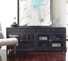 Really love the idea of adding a metal cabinet like this: Shadow Box Industrial Black Metal Media Console