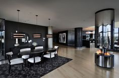 Black walls and columns - a dramatic effect in this apartment flooded with natural light.
