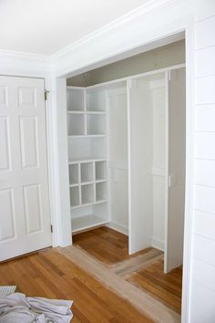 Closet makeover in progress (bifold doors are removed!) - love the cubbies on the end! #closet #makeover #organize #organizing #organization #drapes