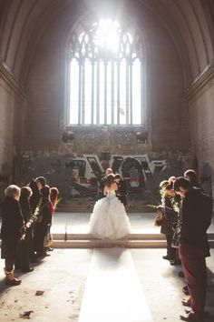 This couple has had a heart for their downcast city...so they had their wedding in an abandoned, graffiti-stained church with broken glass downtown.  Beautiful...