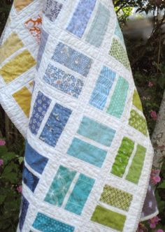 """a finish. Finished size approximately 45"""" x 52"""". Mostly scraps from stash, with Bella White 98 for the sashing and Tula Pink Vintage Stars on the back. Read a bit more about this quilt here and"""