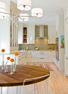This kitchen does not scream mid century, but wouldn't it be cool to incorporate glossy white cabinets into a modern mid century home?