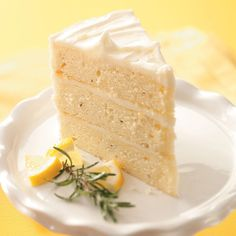 Lemon-Rosemary Layer Cake Recipe -Tall and impressive, this unique dessert is a treat for the senses with flecks of lemon peel and fresh rosemary. Just wait till you taste it! —Mary Fraser, Surprise, Arizona