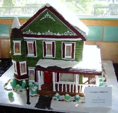 Victorian house made of gingerbread and fondant with isomalt windows and working indoor lights and lampost.