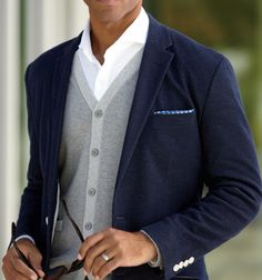Love this look, fantastic classic cardigan, white shirt, and navy blazer with a pocket square. This type of outfit is timeless!