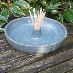Ceramic hors d'oeuvres serving dish with built-in toothpick holder