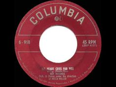 If you were born in 1951 - your folks might have been waltzing to 'My Heart Cries For You' sung by Guy Mitchell