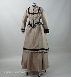 Civil War Era 1860s Three-Piece Fine Ginger Wool and Velvet Bustle Dress. Tulle edging at the collar and cuffs and the owner's name on a homemade tag stitched into the bodice. Via Ruby Lane.