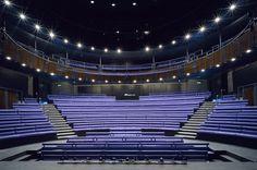 Unicorn Theatre for Children main auditorium with bench seating around thrust or…