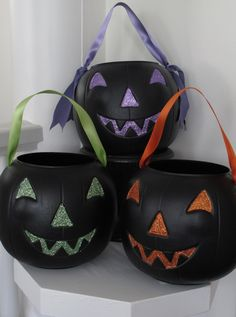 Here's an easy, inexpensive way to add style to store-bought pumpkin pails. Paint the eyes, nose and mouth with glue, glitter them a ghoulish hue, and replace the handle with ribbon. How spooktacular is that? SHARE Related PostsRic Rac PumpkinsDesert RetreatDesigner DIYA Rejuvenated Bedroom for Southern LivingTrick of Nature