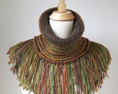 Unique crochet neck warmer in beautiful woodland colours of brown, burned orange, mustard and olive green. A warm and cosy fringed cowl scarf with soft and chunky texture and fun bohemian look. Great way to add accent to your outfit. Crochet Snood, Crochet Neck Warmer, Snood Scarf, Unique Crochet, Chunky Wool, Neck Piece, Neck Scarves, Boho, Hats For Women