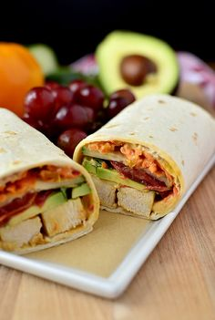 Summer Chicken Wrap: roasted red pepper hummus, shredded carrot, tomatoes, cucumbers, avocado and chicken breast slices | iowagirleats.com