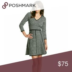 New Calvin Klein's Houndstooth Flare Sweater Dress Stay warm and stylish in Calvin Klein's Houndstooth Print Flare Sweater Dress   V-neck  Fitted bodice  3/4-length sleeves  A-line skirt  Hidden back zip closure  Hits above the knee  Acrylic Calvin Klein Dresses